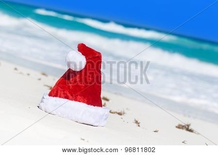 Santa Hat On White Sandy Beach