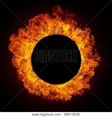 Hot fires flames in rounded shape, isolated on black background. Free copyspace in centre