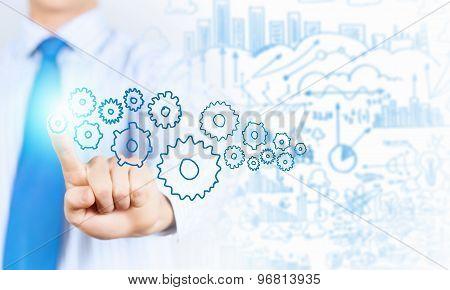 Businessman activating gears mechanism