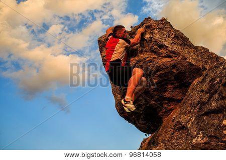 One Guy Climbs On A Rock