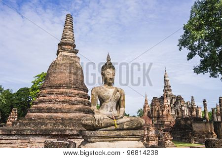 Stupa and Buddha Statue in Wat Mahathat Temple, Sukhothai Historical Park, Thailand