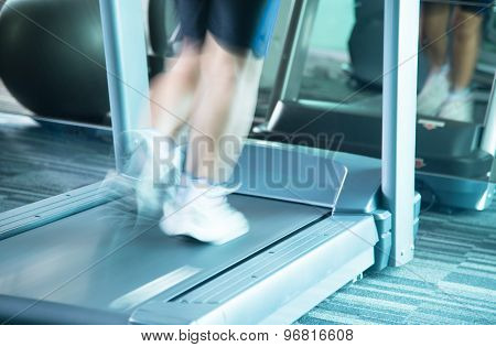 Woman Running With Motion Of Speed By Treadmill