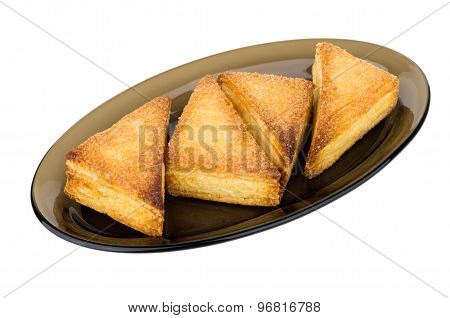 Sweet Puff Pastries In Glass Dish Isolated On White