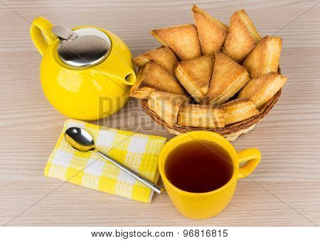 Sweet Puff Pastries In Basket, Teapot And Tea In Cup