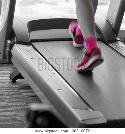 Woman With Pink Shoes Running In Treadmill In The Gym