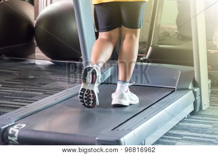 Unknown Woman Running With Treadmill With Motion