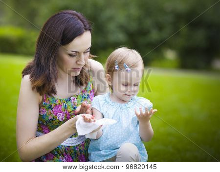 Mother Using Wet Wipes For Her Daughter