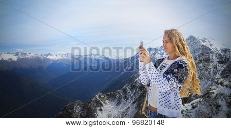 Blond Woman Photographing Winter Landscape Mountains