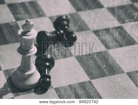 chess pieces and board in antique style