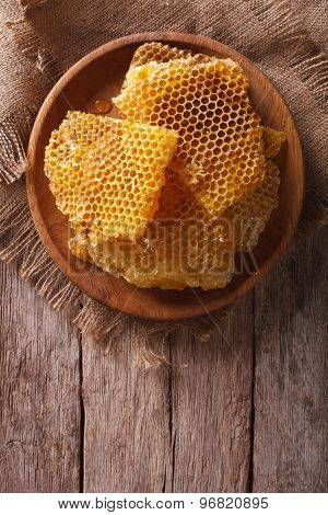 Fresh Honeycombs On A Wooden Plate. Vertical Top View