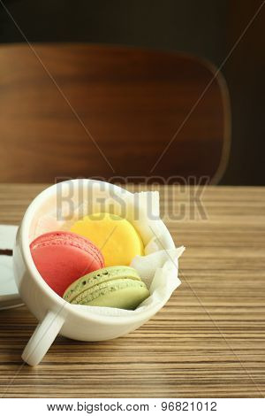 Colourful Of Macaroon On A Brown Table.
