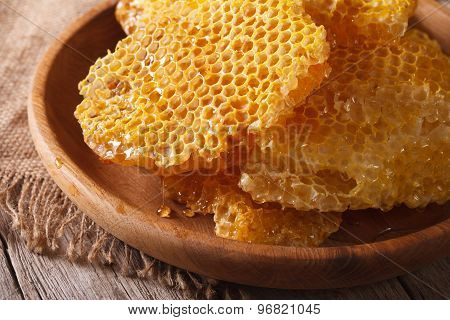 Fragrant Honeycomb On Wooden Plate Close Up. Horizontal