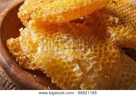 Fresh Golden Honeycomb On Wooden Plate Macro. Horizontal