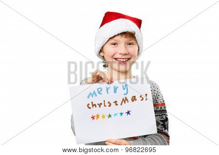 Portrait of a boy in christmas hat holding blank. Isolated