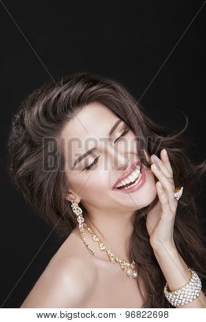 portrait of a beautiful laughing happy brunette girl with luxury accessories. fashion model