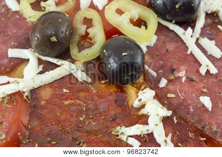 Close Up Of Dark Olives And Paprika On A Homebaked Pizza