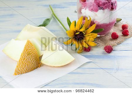 Galia Melon In Front Of Ice Cream Cup