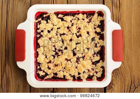 Tasty Homemade Cherry Oat Crumble In Square White Baking Dish On Wooden Table Topview