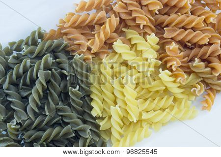 Tri-color Unprepared Pasta Stacked To Form Background