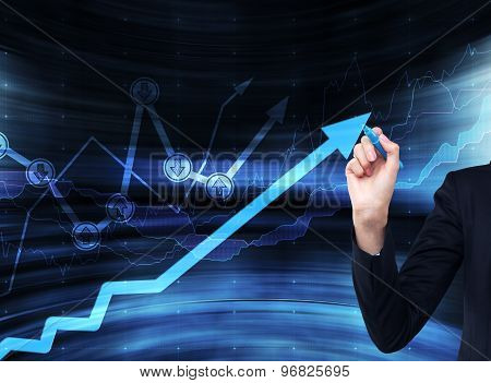A Hand Is Drawing A Growing Arrow On The Glass Scree, Blue Dark Background With Financial Graphs.