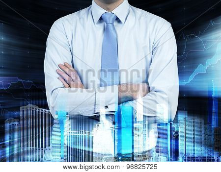 Close Up Of The Businessman With Crossed Hands. Hologram Cityscape On The Front View And Forex Chart