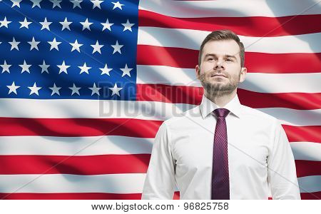 Confident Smiling Businessman. United States Flag As A Background.