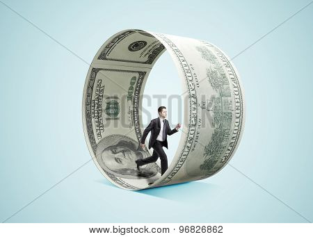 Businessman Running In Money Wheel