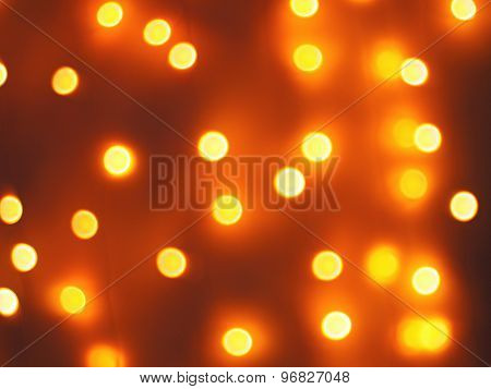 Abstract Defocused And Blur Bokeh Background Of Small Yellow Lights