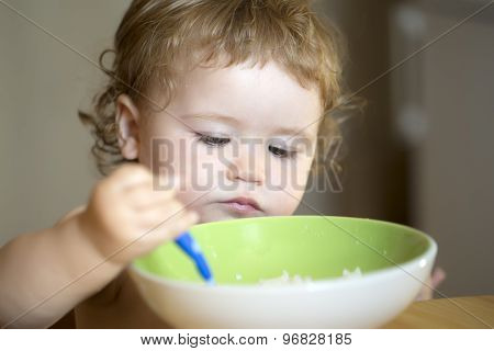 Portrait Of Serious Male Kid Eating