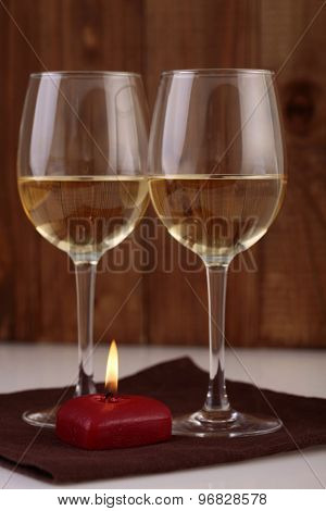 Two Wine Glasses And Candlelight