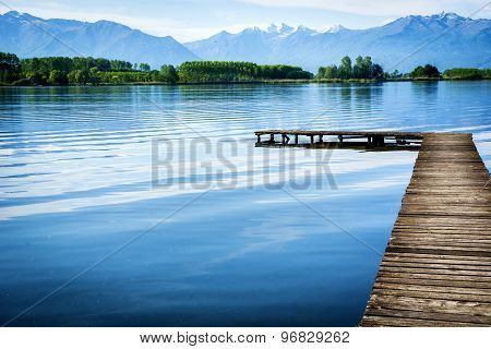 Wooden small pier over peaceful lake