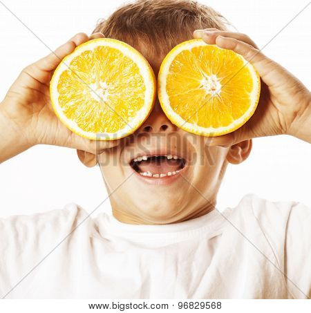 little cute boy with orange fruit isolated on white smiling