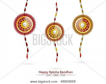 Set of three beautiful creative rakhi on white background for Indian festival, Raksha Bandhan celebration.
