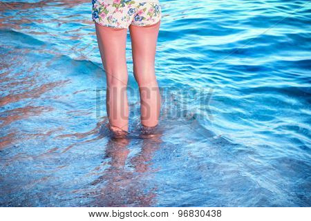 Legs in shallow sea