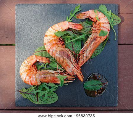 Grilled shrimps on slate plate