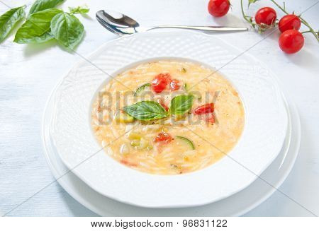 Noodle soup with carrots , potatoes and zucchini