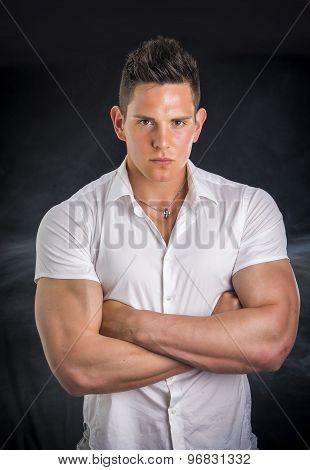 Handsome young man with arms crossed on chest