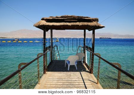 Tropical View Of A Cabin In A Background Of A Deep Blue Sea Taken In Eilat, Israel