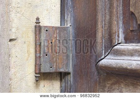 Old and rusty outdoor hinge