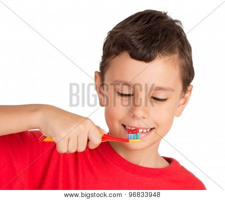 Young boy happily holding a tooth brush ready to brush his teeth