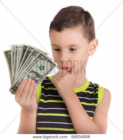 Young boy wondering what to buy with money