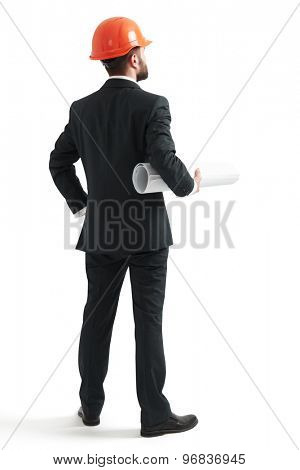 back view of businessman in formal wear and orange helmet holding blueprint. isolated on white background