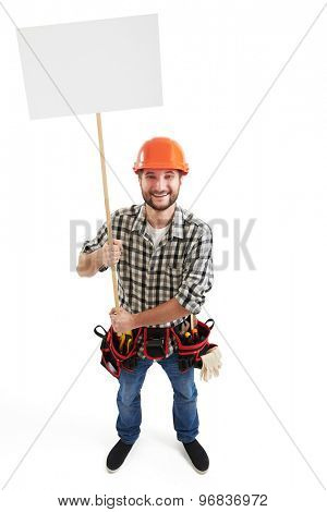 view from above of happy smiley builder with white placard for your text. isolated on white background