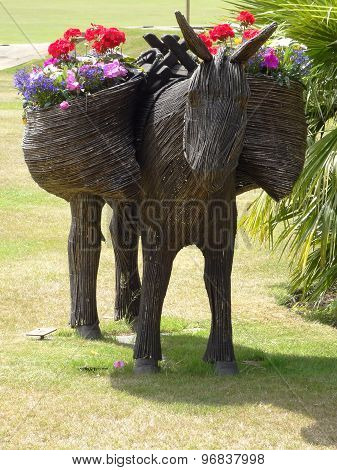 Wicker Donkey With Flowers And Palm Trees