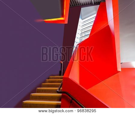 Staircase painted in red. Abstract fragment of the architecture of modern lobby, hallway of the luxury hotel, shopping mall, business center in Vancouver, Canada. Interior design.