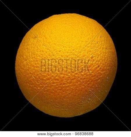 Orange fruit on black background