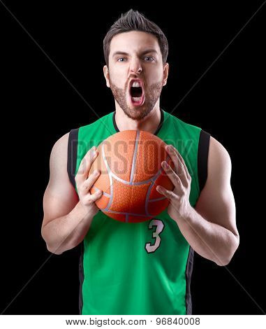 Basketball Player on a green uniform on black background