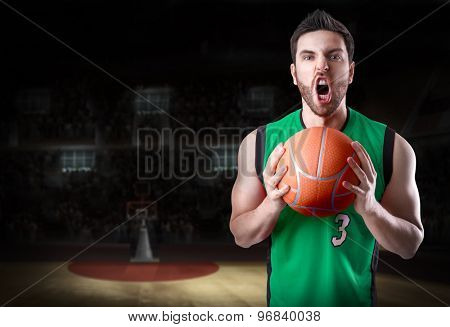 Basketball Player on a green uniform in basketball court
