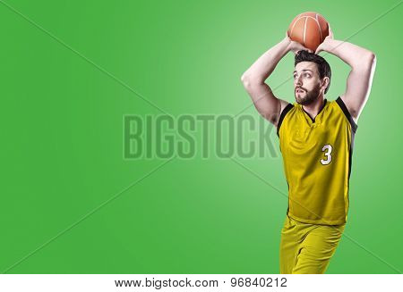 Basketball Player on a yellow uniform on green background