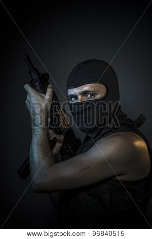 Thief, Man wearing balaclavas and bulletproof vest with firearms